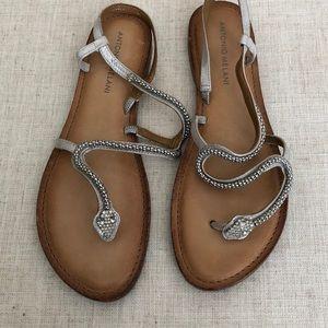 Snake jeweled strappy sandal.